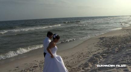 bride and groom on beach