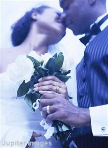 Just married couple kissing blue photograph
