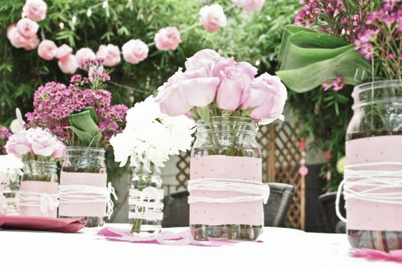 Lovely light pink roses white mums and wax flowers make up bridal shower