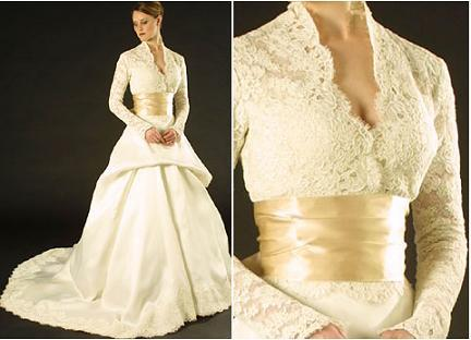 Beautiful ivory Monique Lhuillier lace wedding dress with v-neck and champagne cumberbund