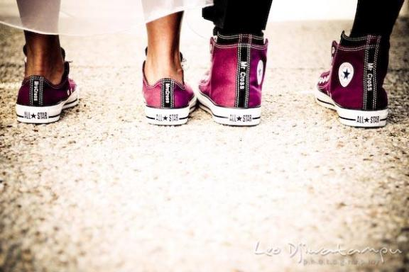 Bride and groom wear Converse wedding shoes