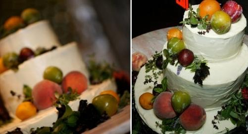 Beautiful white organic wedding cake decorated with vibrant fruit and herbs