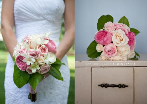 bride holds assorted light pink roses bridal bouquet wearing white strapless