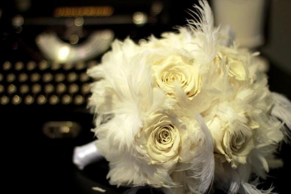 Bridal bouquet of ivory roses and feathers