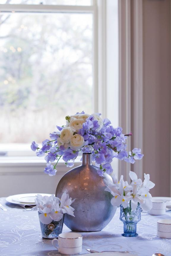 Whimsical ivory, blue and lilac wedding flower centerpieces