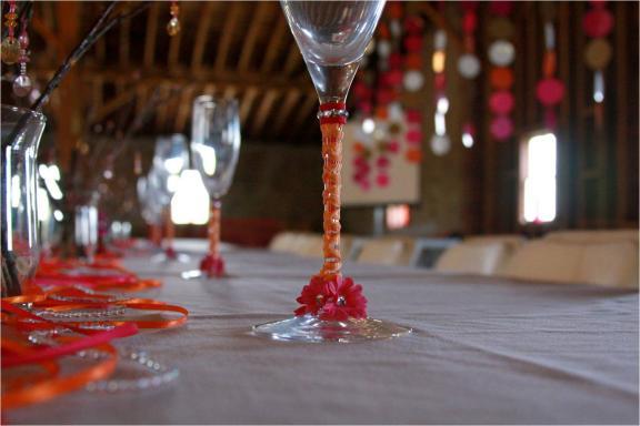 wedding detail photo hot pink orange wedding color palette wine glasses at