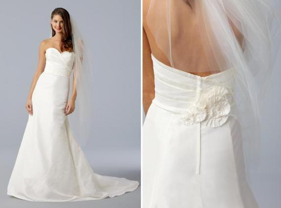 Stunningly simple white a-line sweetheart wedding dress with  origami pleats and flower in back
