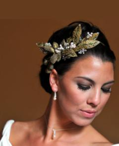 Grecian Goddess bridal updo- this wedding hairstyle updo is sleek, adorned with a gold leaf bridal hair accessory