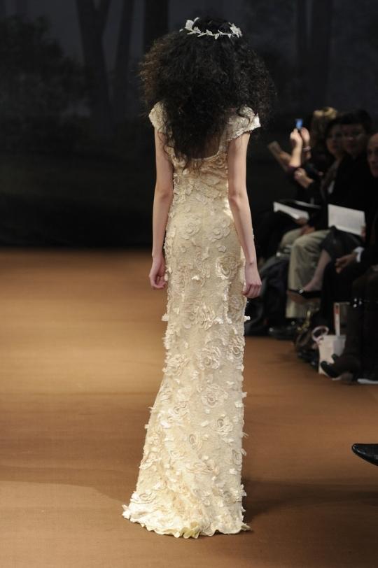 Claire Pettibone 39s wedding dress style Faye is a beige scoop neckline