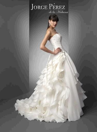 Jorge Perez 39s wedding dress style 8 is an ivory strapless neckline ball