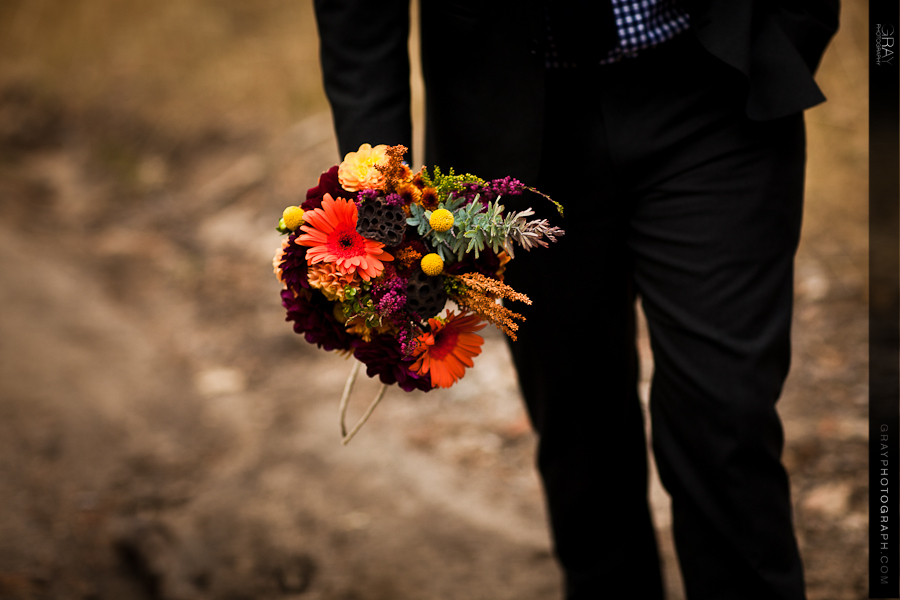Fall-wedding-flowers-bouquets-and-centerpieces-groom-holds-bouquet.full