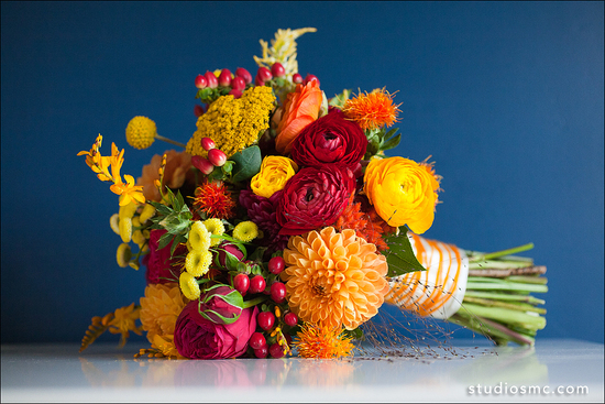 fall wedding flowers bouquets and centerpieces colorful orange red yellow