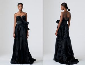 photo of vera wang spring 2010 wedding dresses black wedding dress sleek chic oversized bow at natural waist