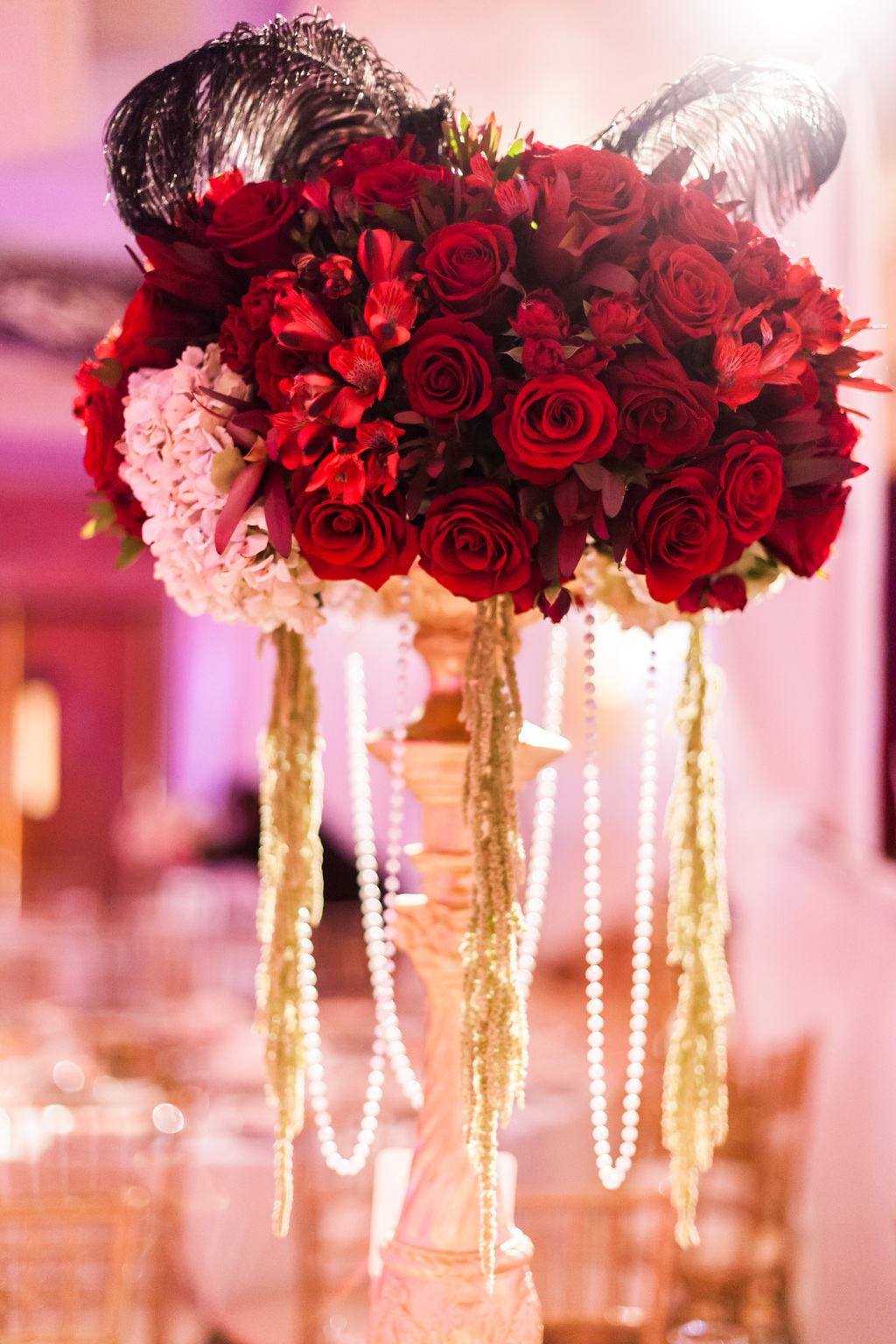 Epic-wedding-in-los-angeles-california-weddings-red-rose-with-feathers-pearls-centerpiece.full
