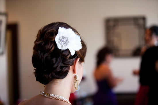 Bridal Updo with white feather hair flower