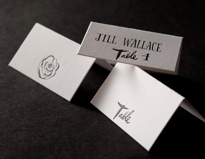 Modern-wedding-escort-cards-embossed-roses.full