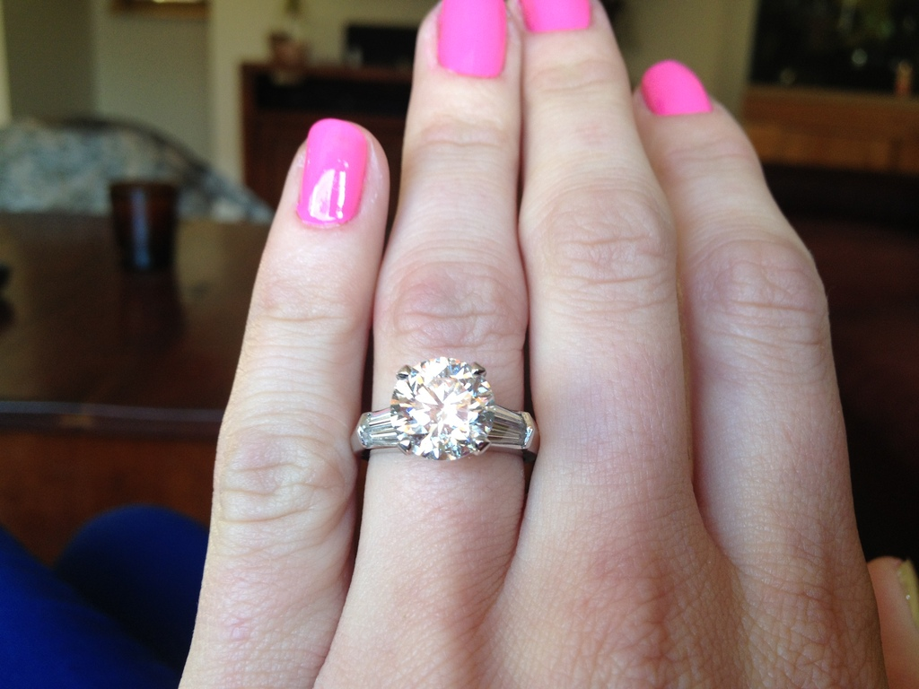 Real-engagement-stories-platinum-engagement-ring-with-round-center-stone-and-baguettes.full