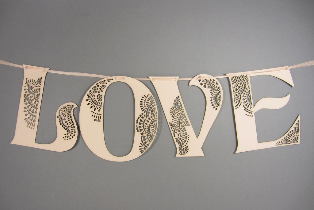 Handmade-wedding-finds-laser-cut-love-sign.full