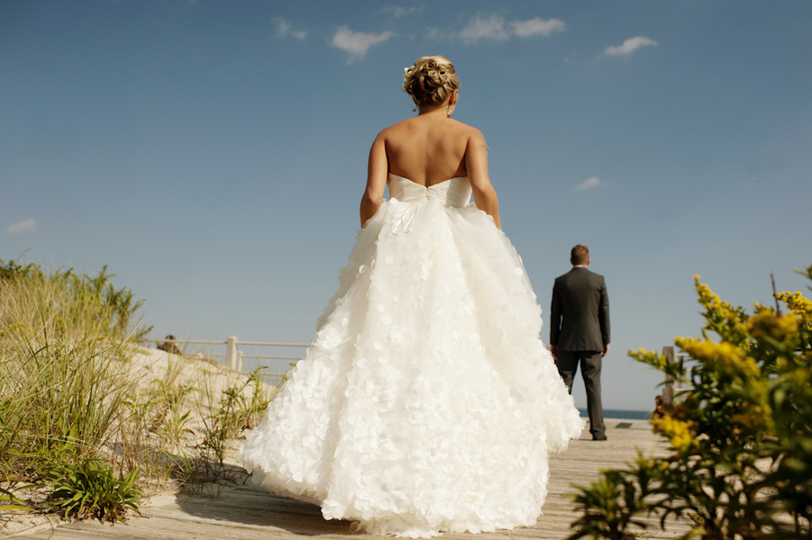 First-look-wedding-photos-bride-approaches-groom-from-behind.full