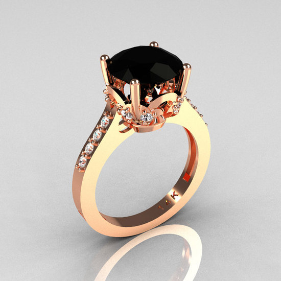 photo of gold black wedding engagement ring