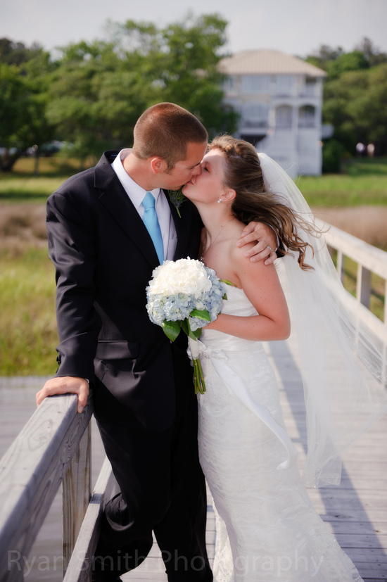 Bride and Groom kissing on inlet pier - Ocean Isle_4604505120_o