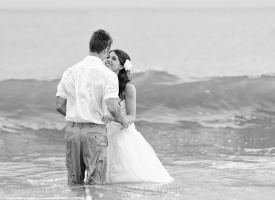 Bride and groom in the ocean_7150872569_o