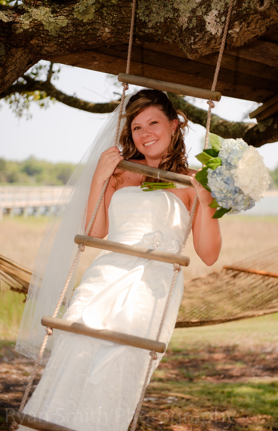 Bride swinging on rope ladder - Ocean Isle Beach_4598717901_o