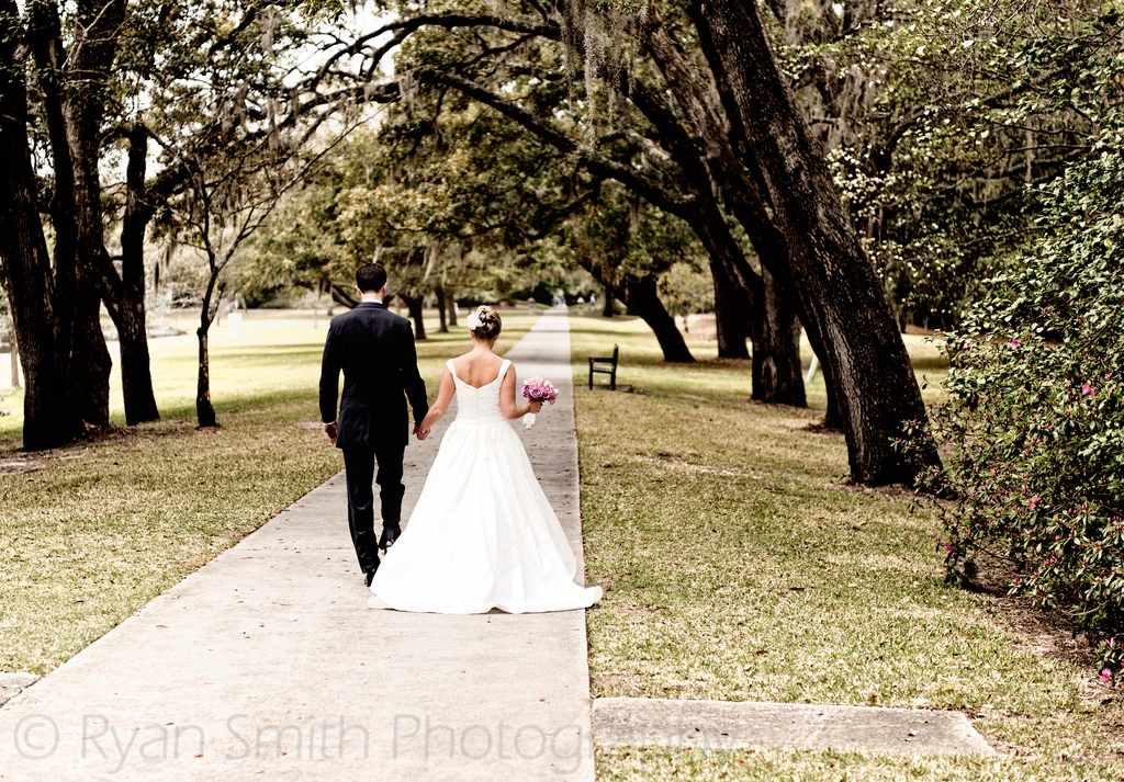 Bride%20and%20groom%20walking%20down%20sidewalk%20through%20the%20trees%20-_5839853441_o.full