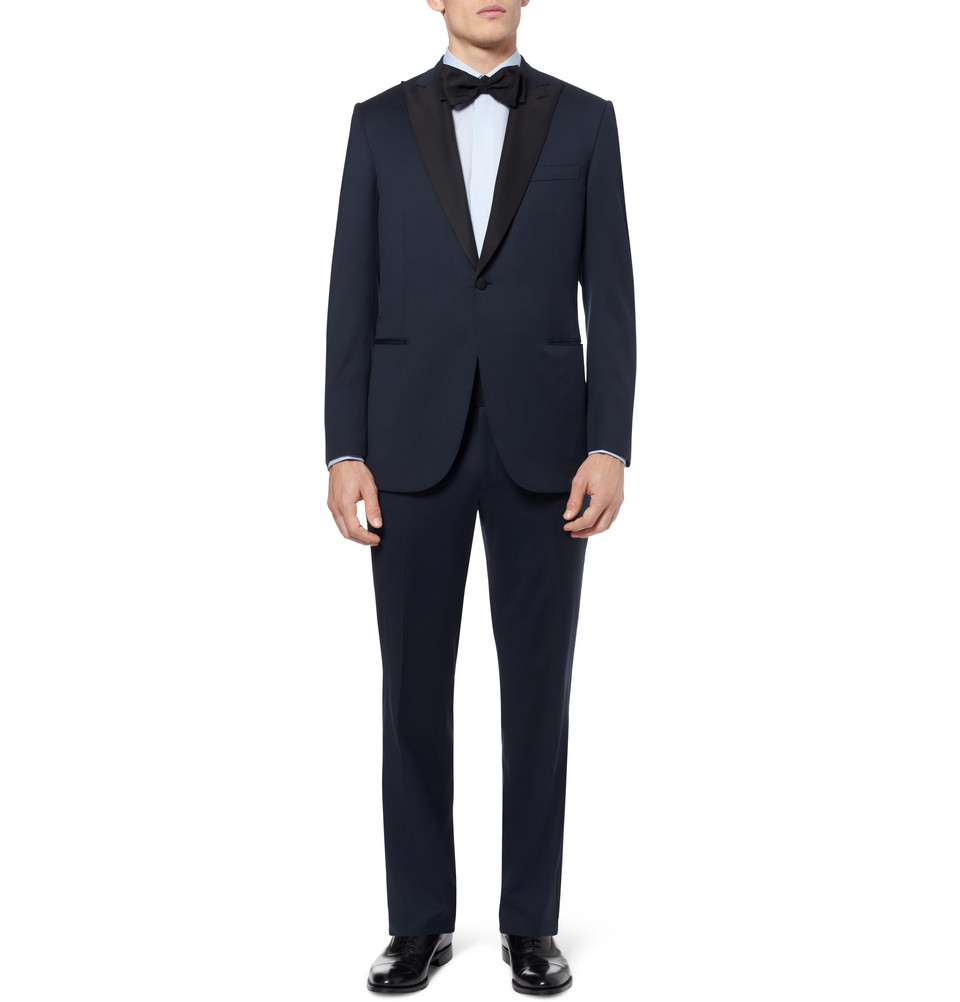 Deep-blue-tuxedo-for-the-groom-with-black-accents.full