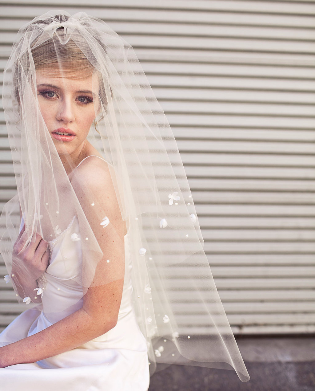 Traditional-bridal-veil-with-white-petal-applique.full