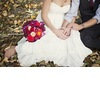 Fall-bride-and-groom-pose-outside-with-red-bridal-bouquet.square