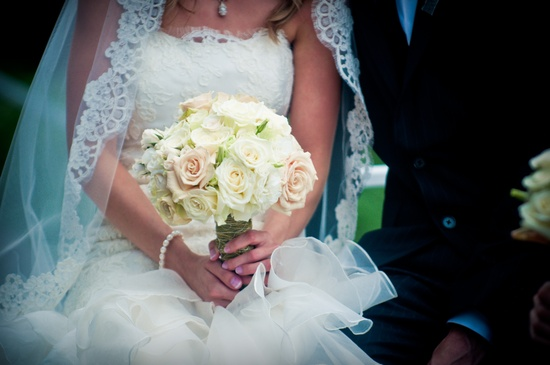 photo of Classic bridal bouquet of ivory light pink roses