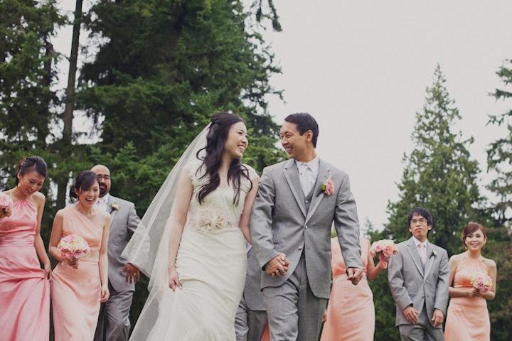 Bride-and-groom-walk-hand-in-hand-after-outdoor-ceremony.full