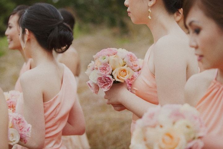 Light-coral-bridesmaid-dresses-pink-and-peach-bouquets.full