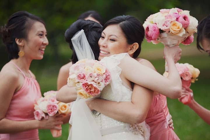 Beautiful-bride-hugs-bridesmaids-after-ceremony.full
