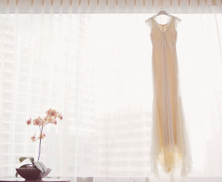 78b306dc073 Lace Wedding Dress Hangs in Window