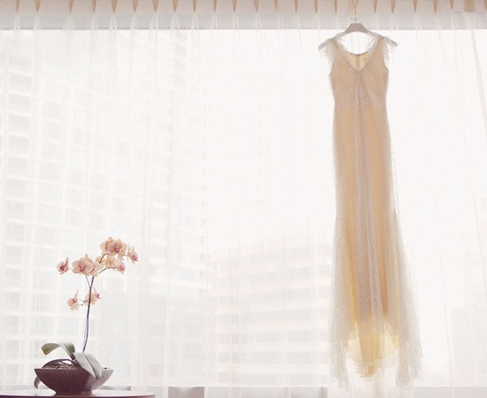 Lace Wedding Dress Hangs in Window