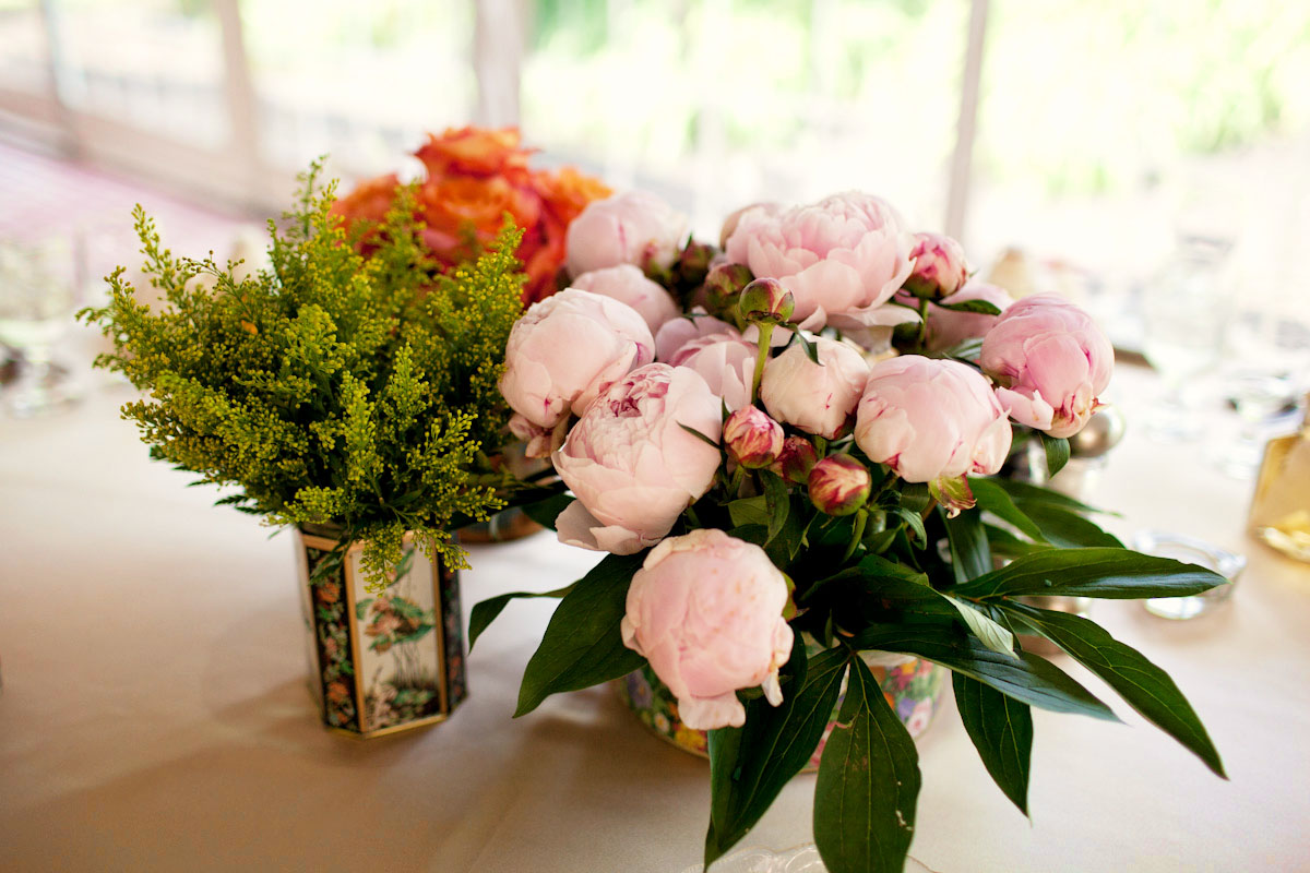 Wedding centerpieces light pink peonies orange roses in