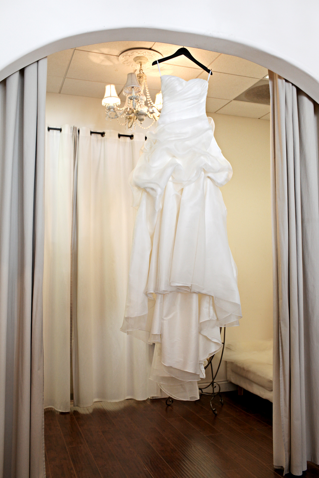 Brides-wedding-dress-hangs-in-doorway.full