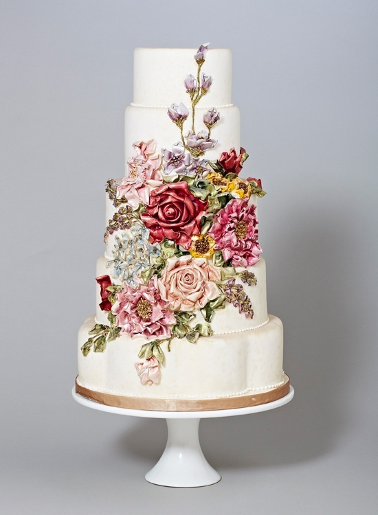 photo of Stunning Wedding Cake with Rich Floral Design