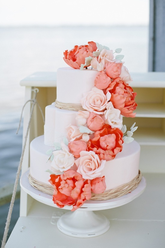 photo of Romantic 3 Tier Wedding Cake with Peach Coral Blooms