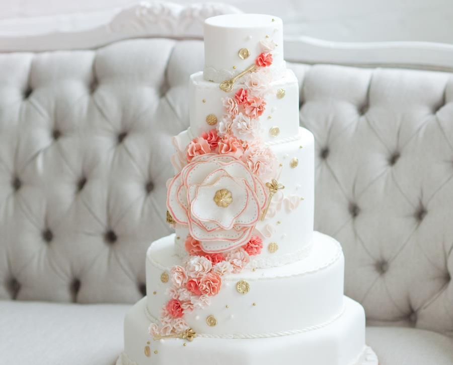 Classic-white-wedding-cake-peach-gold-cascading-blooms.full