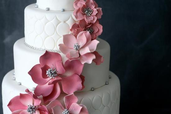 photo of Elegant White Wedding Cake with Light Pink Blooms Silver Beads
