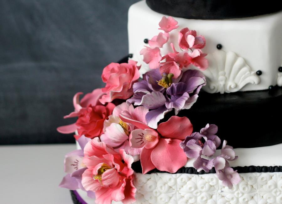 Black and white wedding cake with pink purple sugar blooms mightylinksfo