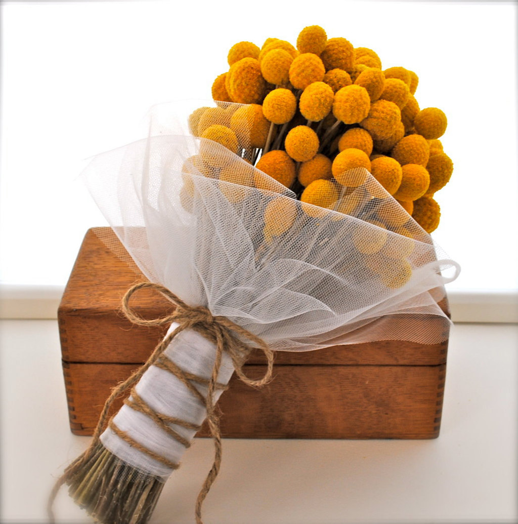 Yellow-crespedia-bridal-bouquet-wrapped-in-tulle.full