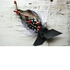 Feather-and-berry-grooms-boutonniere.square