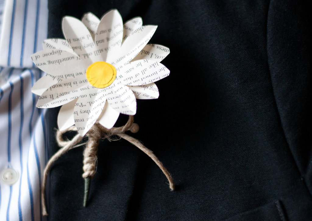 Book Page Grooms Boutonniere