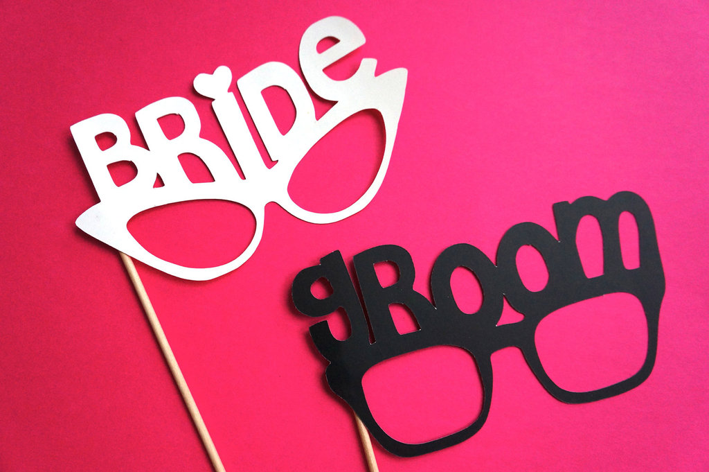 Cute bride and groom wedding photobooth props