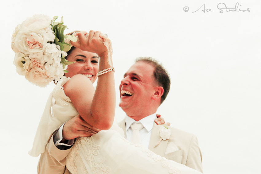 Happy-bride-and-groom-in-khaki-and-ivory.full