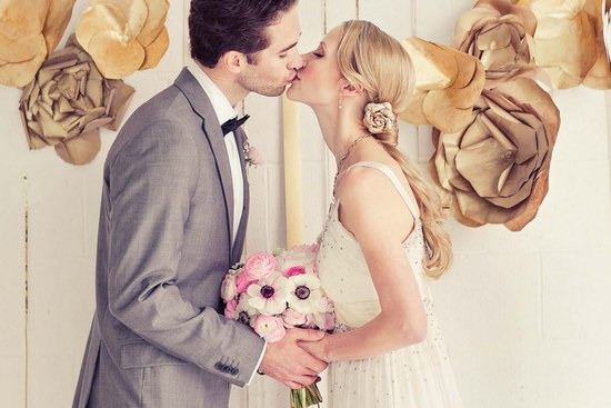 NYE Wedding Inspiration Glittery Gold Bride and Groom Kiss